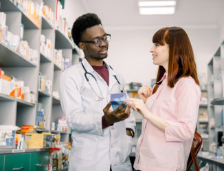pharmacist showing some data to customer